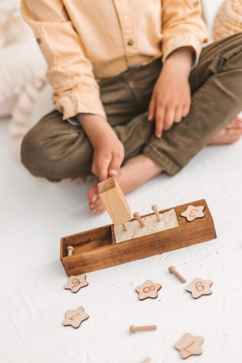 Wooden hammer toys by Woodinout Montessori toys