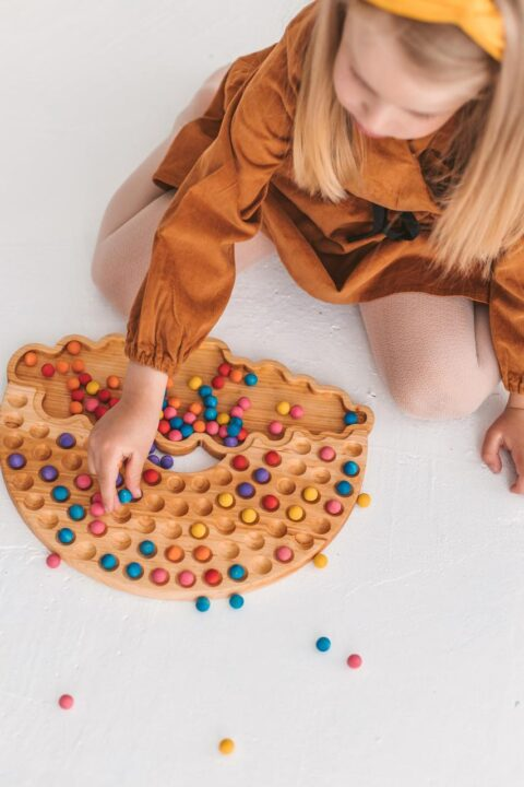 Wooden Rainbow toy - sorting colors game